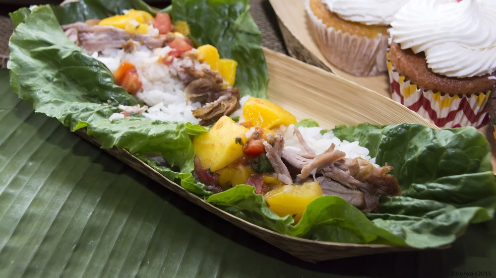 Detail of pork lechon lettuce wraps, foreground, and tropical cupcakes by Chef Joelen Kenny of What's Cookin' Chicago!? Photo credit: Gen Odon