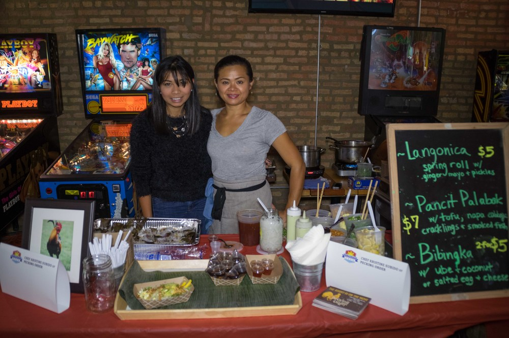 Chef Kristine Subido, right, and her cousin, Monica Bernardo, of Pecking Order Catering. Pecking Order can be found at the Logan Square and Andersonville Farmers' Markets in Chicago. Photo credit: Bryan Becares.