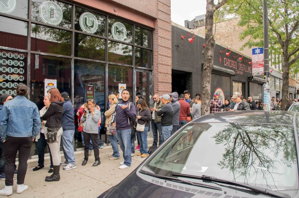 Excited to be close to the head of the line outside Emporium Logan Square. Photo credit: Bryan Becares.