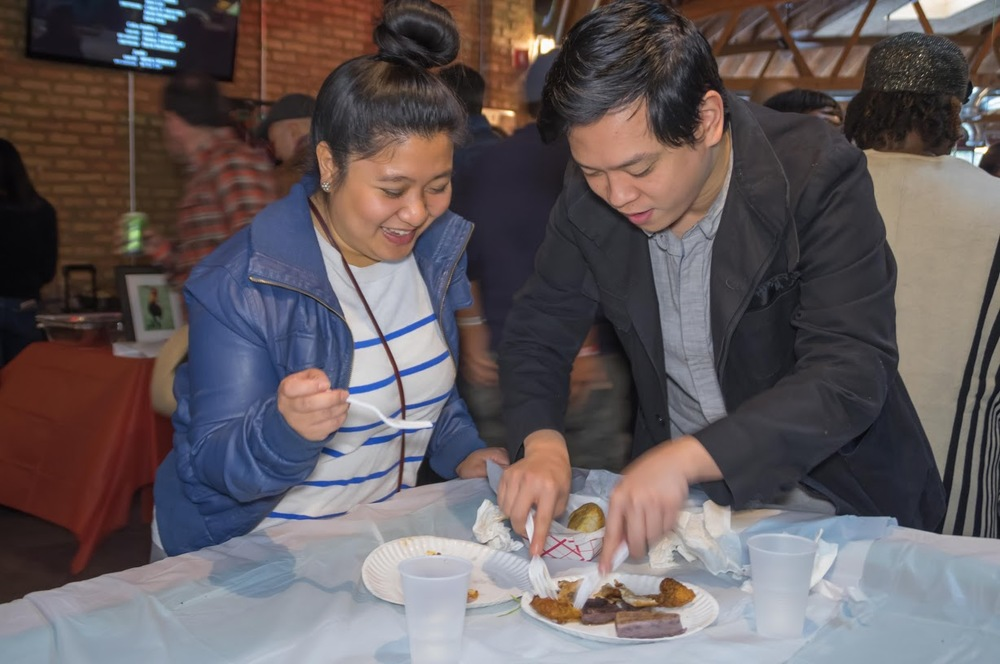 Chowing down on the Filipino fare at Kultura. Photo credit: Bryan Becares.