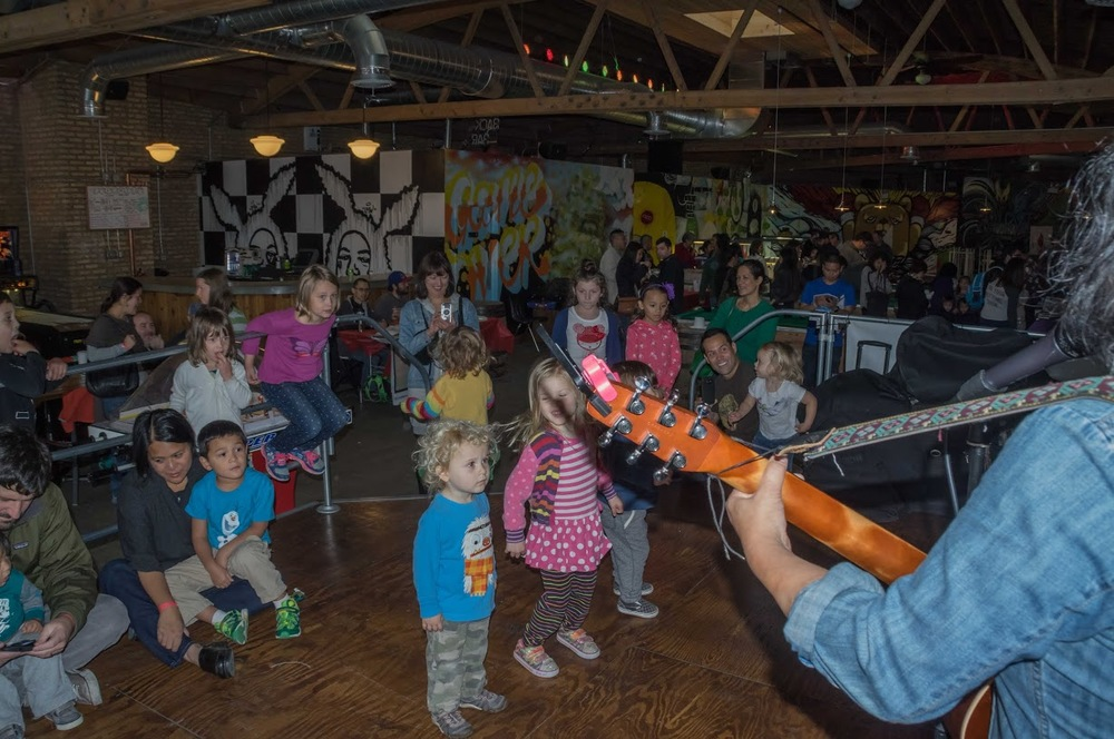 Musician Ann Torralba, also known as Little Miss Ann, foreground right, gets the kids at Kultura singing and dancing! Photo credit: Bryan Becares.