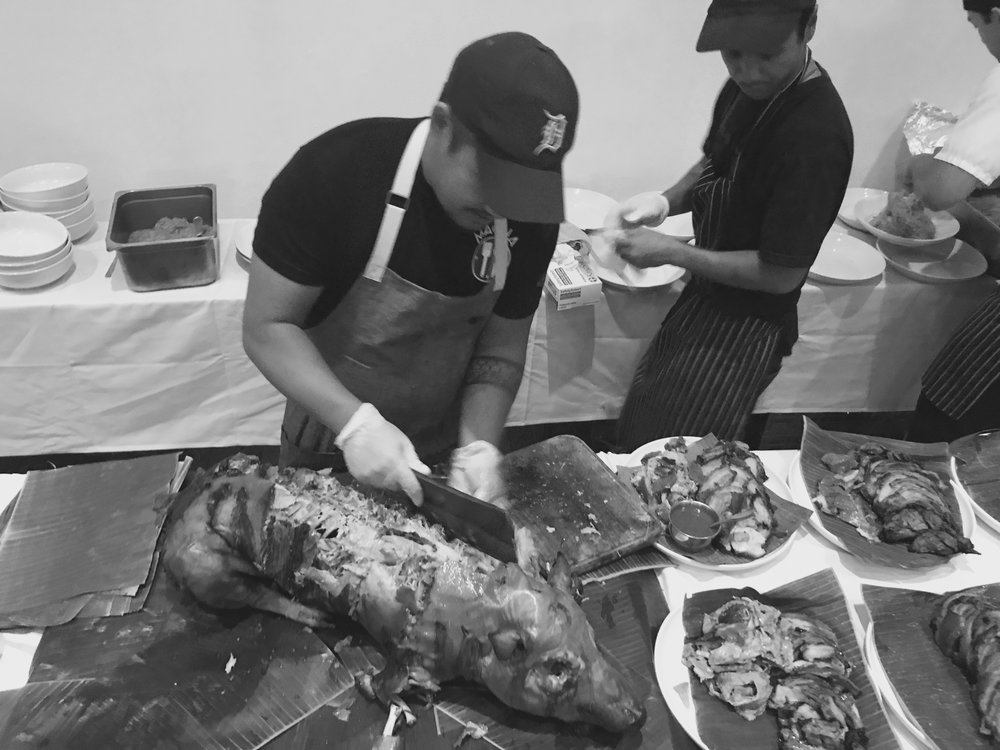 Chef Lamagna portions the lechon.