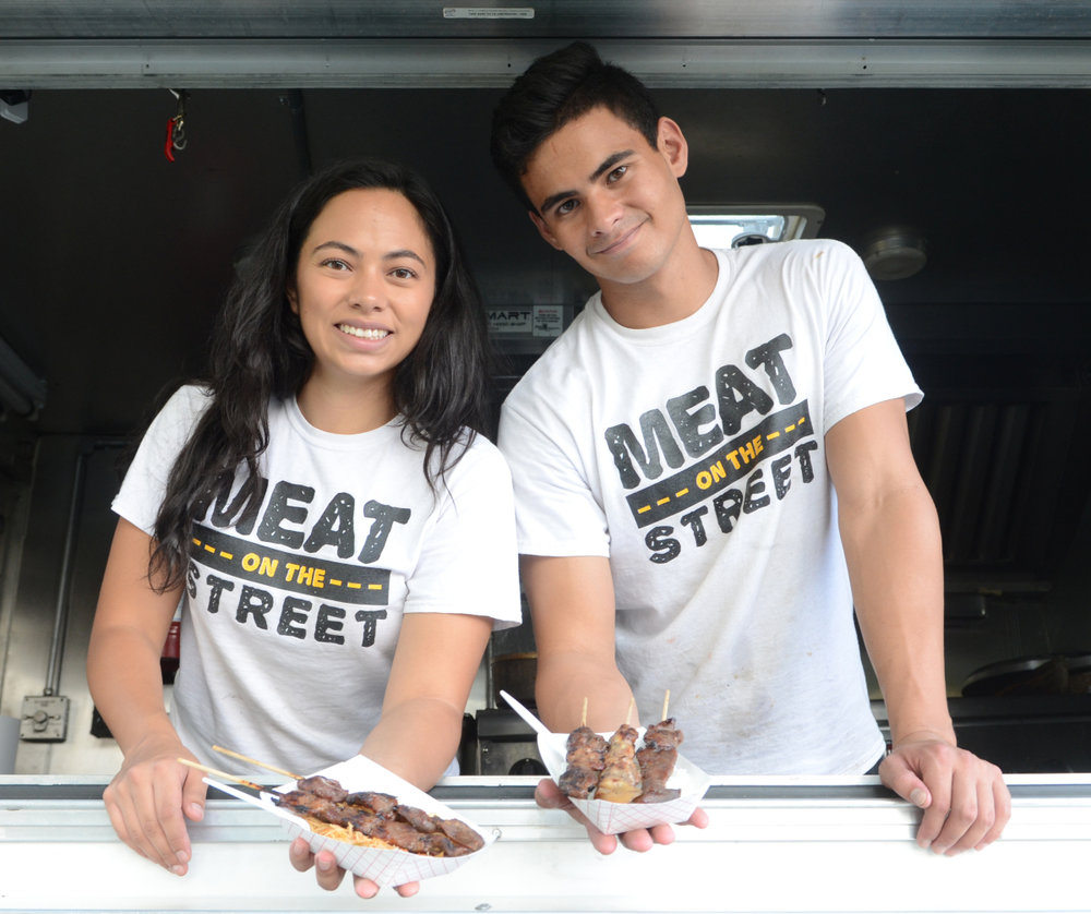 ALEXA ALFARO: MEAT ON THE STREET MILWAUKEE, WISCONSIN  Facebook:  Meat on the Street  Twitter:  @meatstreet_mke  Instagram:  @meatonthestreet   If it weren't for the Filipino noodle dish, pancit, Alexa Alfaro, her siblings and Filipino food in Milwaukee wouldn't probably exist today. Sounds far-fetched? It won't be after you read this story. Once upon a time, in a faraway and sparsely populated land called Alaska, there lived a Filipino immigrant named Ray Alfaro. Ray, born and raised in Caloocan City, worked at a hospital where he met Deb Fucile, an Italian-German nurse from Wisconsin. Ray fell head over heels for Deb. Problem was he couldn't muster the guts to ask her out. Then an idea formed. Why not get someone to do it for him? And so he asked a colleague, an avid pancit fan, to be his messenger in exchange for pancit. Long story short, Ray and Deb wed and had three children. One of them is Alexa, who now with her brother Matthew, owns Meat on the Street, the first and only Filipino food vendor in Milwaukee, Wisconsin.