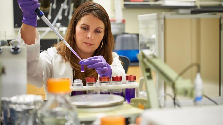 LambdaVision CEO Nicole Wagner pipettes in the lab at the University of Connecticut Cell and Genome Sciences Building in Farmington on 9 June 2016. Photo Courtesy: Peter Morenus | University of Connecticut