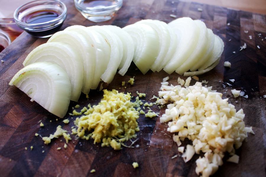 Half the onion, then sliced across into 1/2 inch pieces. Mince the garlic and ginger, so that it brings flavor without adding too much texture.
