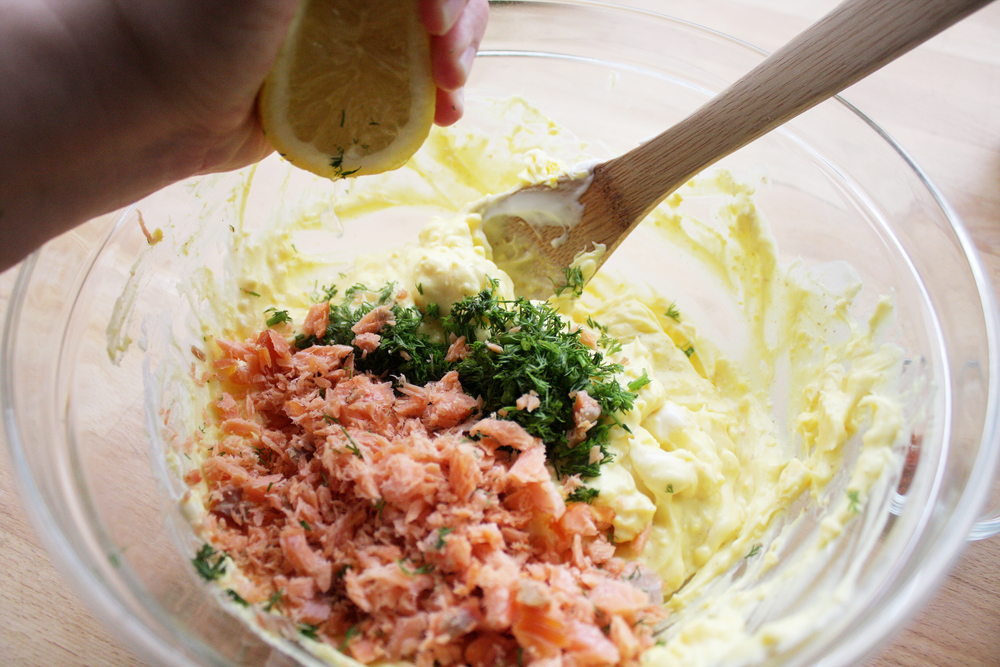 Mix in the smoked salmon, dill and the juice of half a lemon into the mixture. Add salt and pepper if needed.