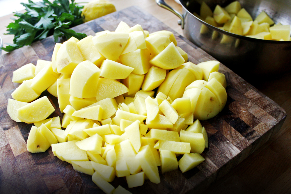 Using Yukon potatoe's natural buttery texture is perfect for this dish. Peel and rough chop into bite sized pieces, then take a quarter of those potatoes and make them even smaller. Those will break down when boiling.
