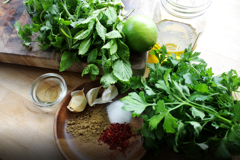 The Ingredients: Olive oil, cilantro, mint, parsley, lime, garlic, cumin, vinegar, gochugaru, salt.