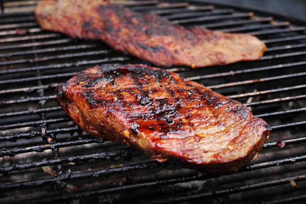 On the grill, sear the steaks - about 4 minutes on each side for a thicker cut and about 2 minutes for a thinner cut - then move to the cooler zone in your grill until it's done to your liking.