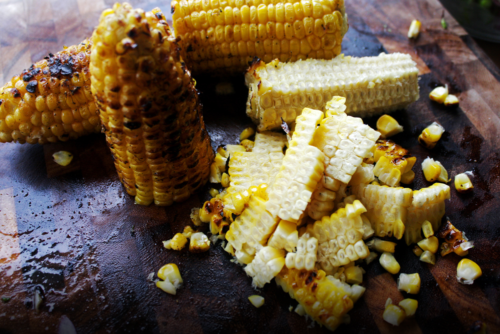Cut the sides of the corn cob to get the kernels off. Cut the cob in half first to help avoid the kerrnels flying all over the place.