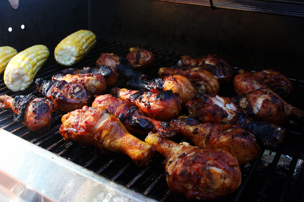 Turn your chicken every 5-7 minutes to evenly cook the drumsticks, closing the lid of your grill in-between turns. Do this for about 35-40 minutes, or until there's no pink flesh when you tear away a thick piece of the meat from the bone.