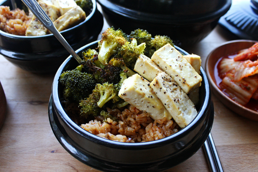 Serve the tofu and broccoli on top of the garlic rice with a side of kimchi.