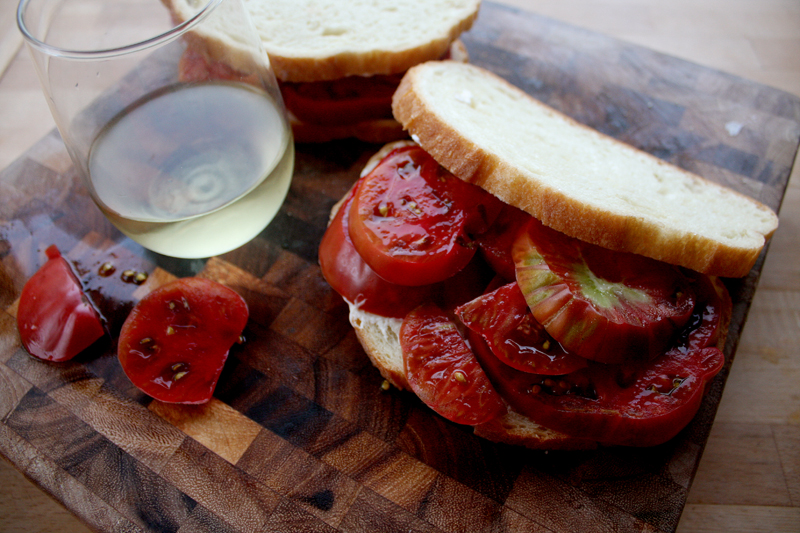 Then top with the other slice of bread and serve right away. The tomatoes will be oozing with juice, so you don't want to wait too long and have your bread be soggy.