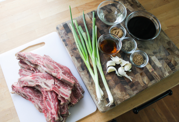 The ingredients: kalbi, green onions, garlic, soy sauce, rice wine vinegar, sesame seed oil, brown sugar, black pepper, and sesame seeds.