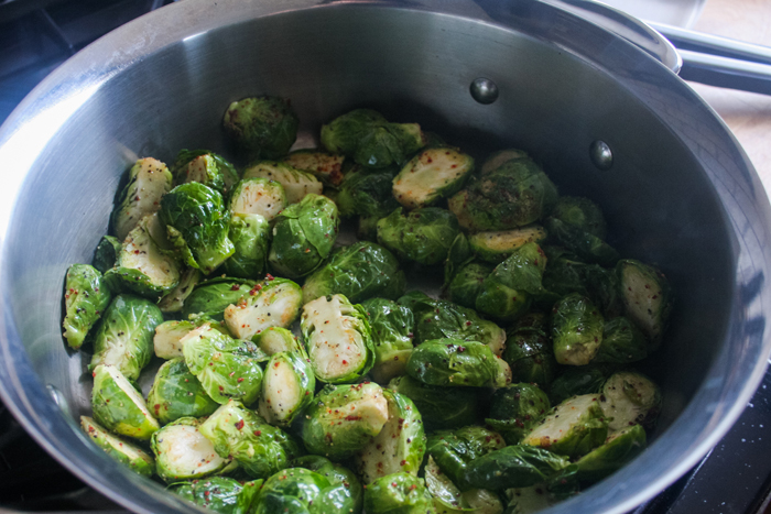 Get the pan hot on high heat. Carefully put the brussel sprouts in and dont move them around for about 3-5 minutes.