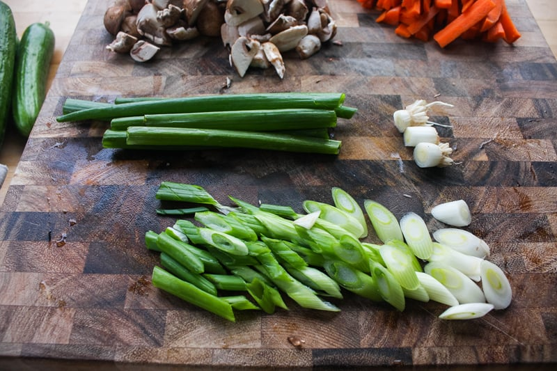 Cut the green onions into small pieces. Reserve the top half to sprinkle on top of the bibimbap.