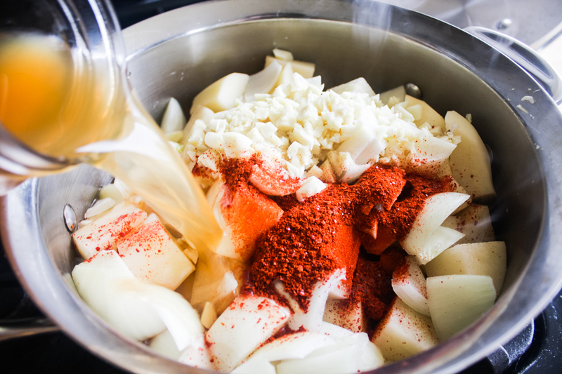 Throw the potatoes, white onion, garlic, ginger, gochugaru, salt, and vegetable stock in a medium pot.