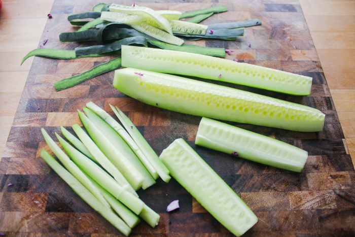 Peel and deseed the cucumber. Cut into thin slivers, about the length of the spring roll.