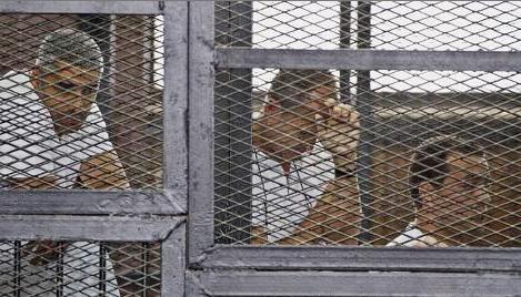 Al-Jazeera correspondents Peter Greste, Mohammed Fahmy and Baher Mohammad.