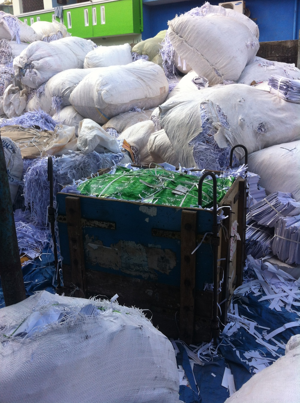 Shredded paper being baled before being transported.