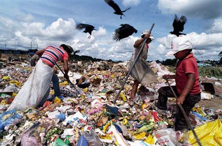 Waste-pickers from Brazil, working at a dumpsite.