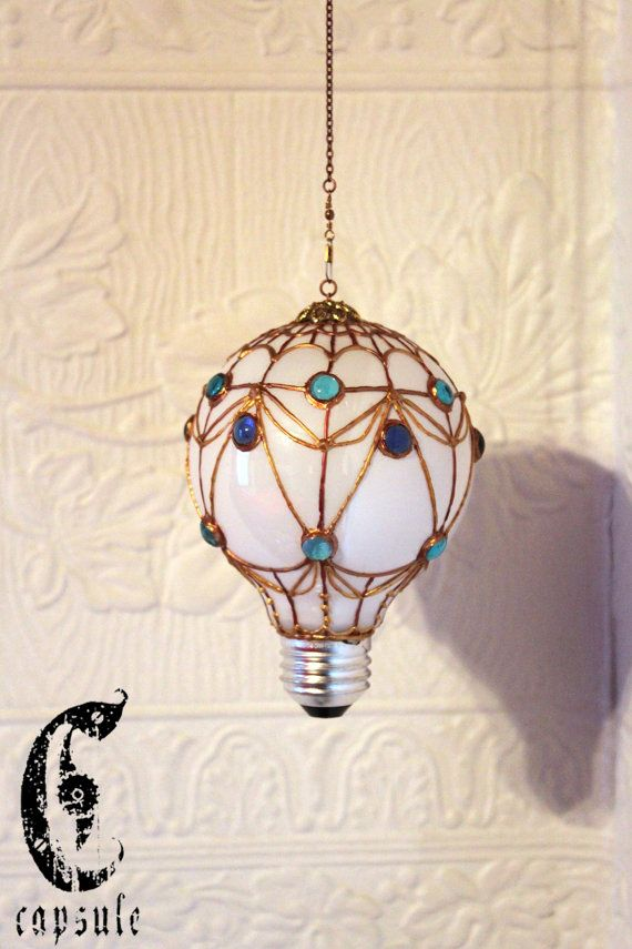 A parachute made from an incandescent bulb. More on Etsy