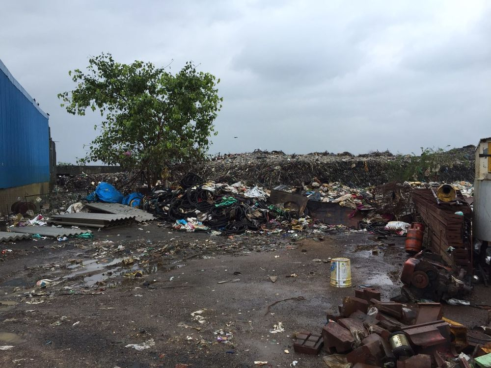 New dumpyard at Pammal, with trash scattered everywhere.