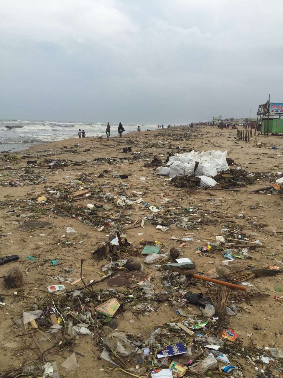 Trash thrown back from the ocean at Besant Nagar beach, after unprecedented flooding caused the complete submersion of the sand.