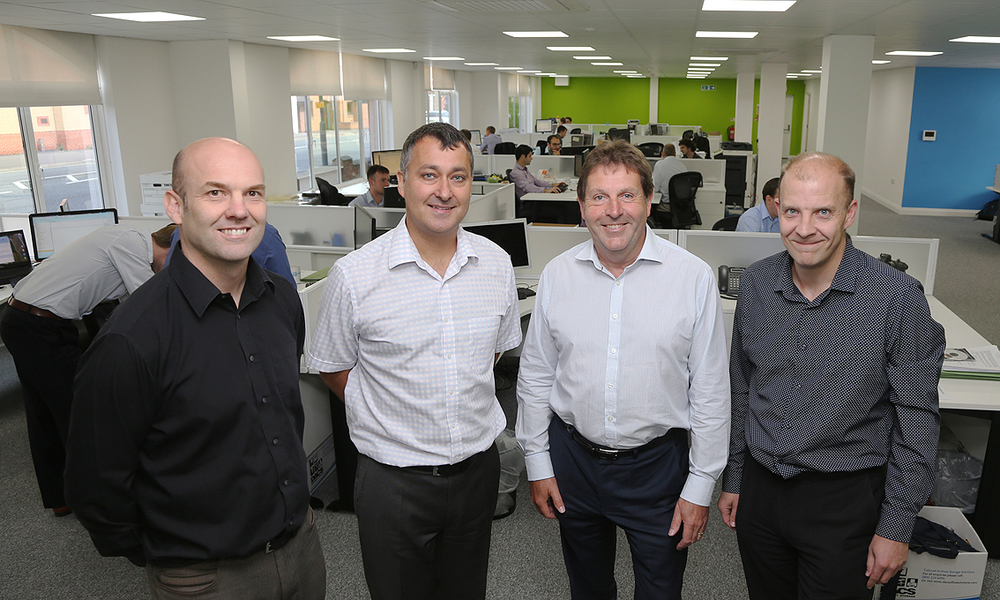 Rodgers Leask Directors: (left to right) Stewart Friel, Lawrence Pacey, Andy Leask and Paul Spencer with staff at their new Derby premises.