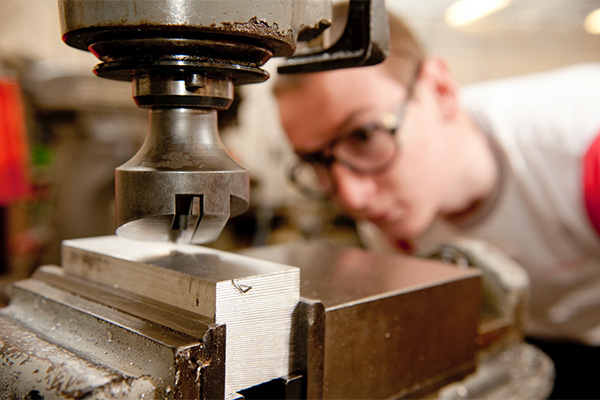 A Motorsport student works on machinery in the engineering workshop at the University of Derby's Markeaton Street site.