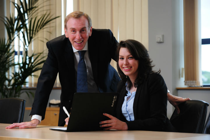 Partner at Geldards, Nino Simone (left) pictured with Derby College student Nicola Wetton.