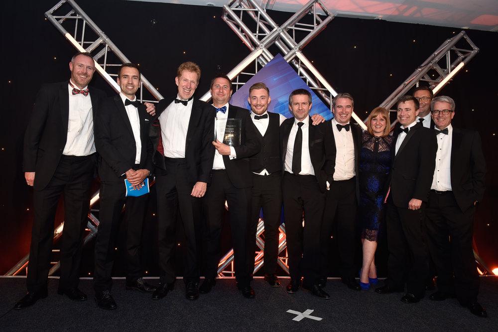 Smith Cooper collecting their award.