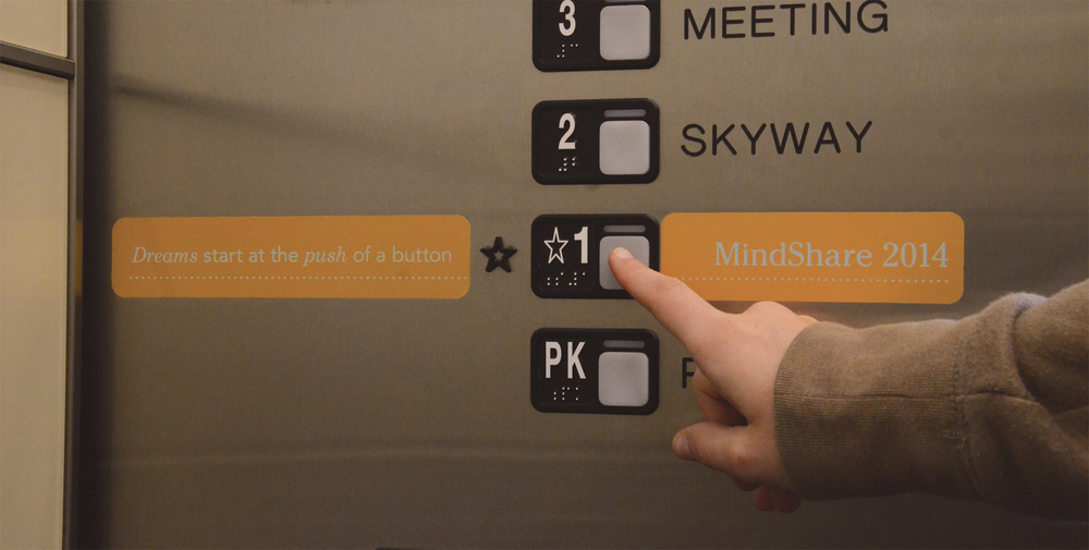 - Environmental graphics, including door clings and elevator buttons, were implemented to greet guests as they arrived at MindShare.