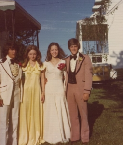 My mom in High School.  She is in White.Prom (1976)