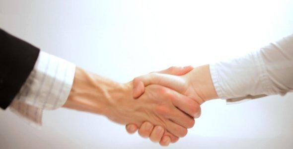 businessman-and-businesswoman-shake-hands