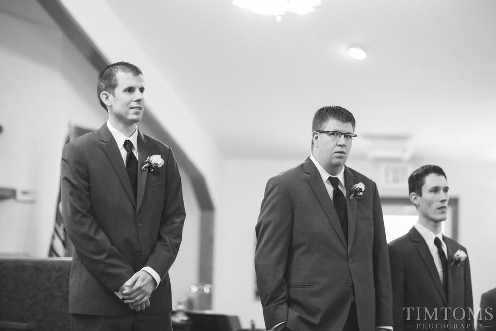 Groom waiting at altar bride first look reveal