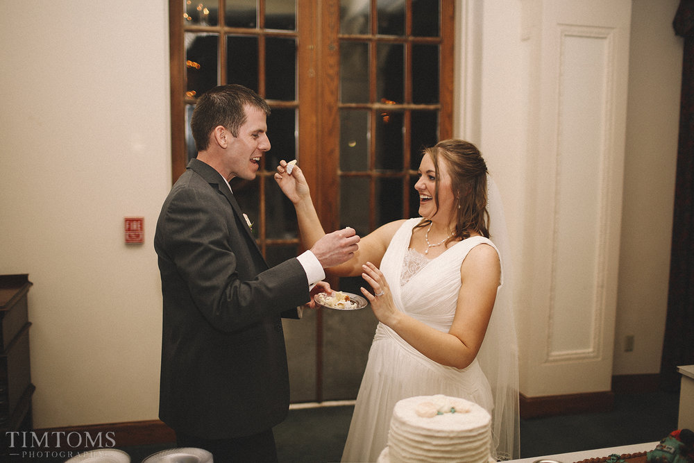 Bride and Groom eat cake wedding