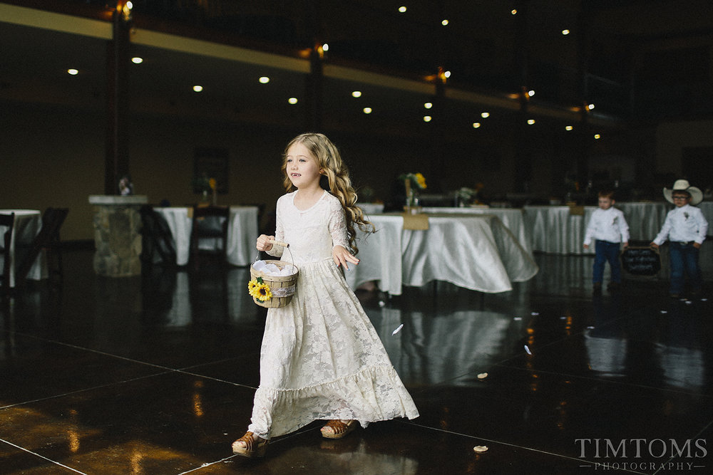 Flower girl coming down aisle