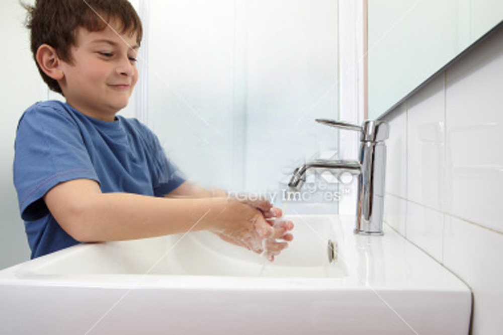 stock-photo-20410510-boy-washing-hands.jpg