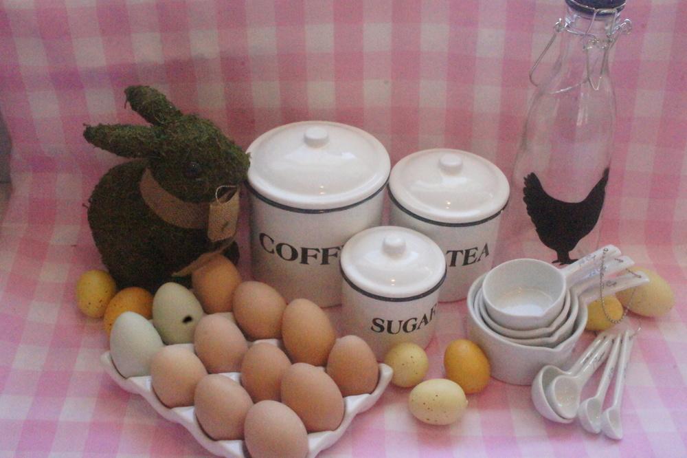 Farm Home Shop items: Glass Bottle, Ceramic Measuring Set, Enameled Metal Canister Set.