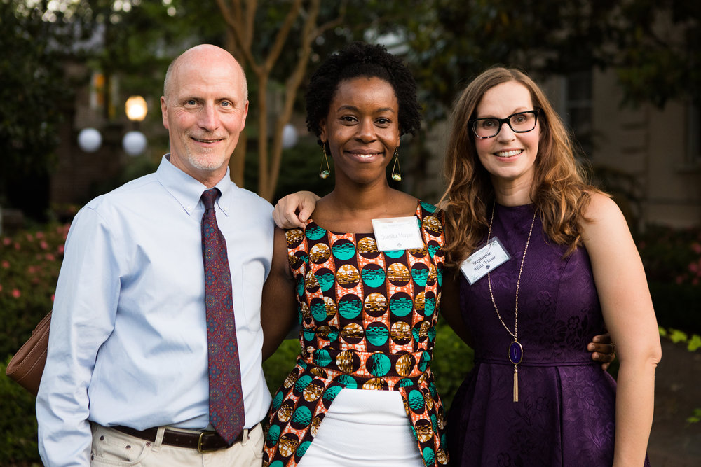 Jamila Harper, Bonner and College of Charleston '08 alum, surrounded by Bobby Hackett, President of the Bonner Foundation, and Stephanie Visser, Director of the Center for Civic Engagement.