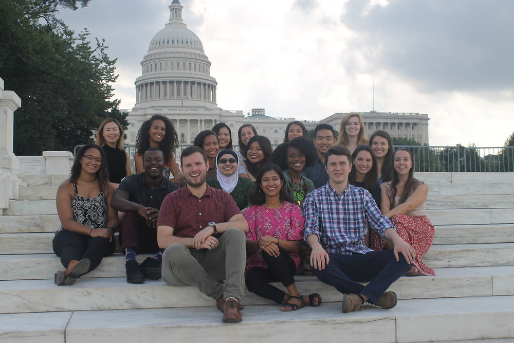 The 25th Class of Emerson Fellows post for a photograph near the end of their field training.