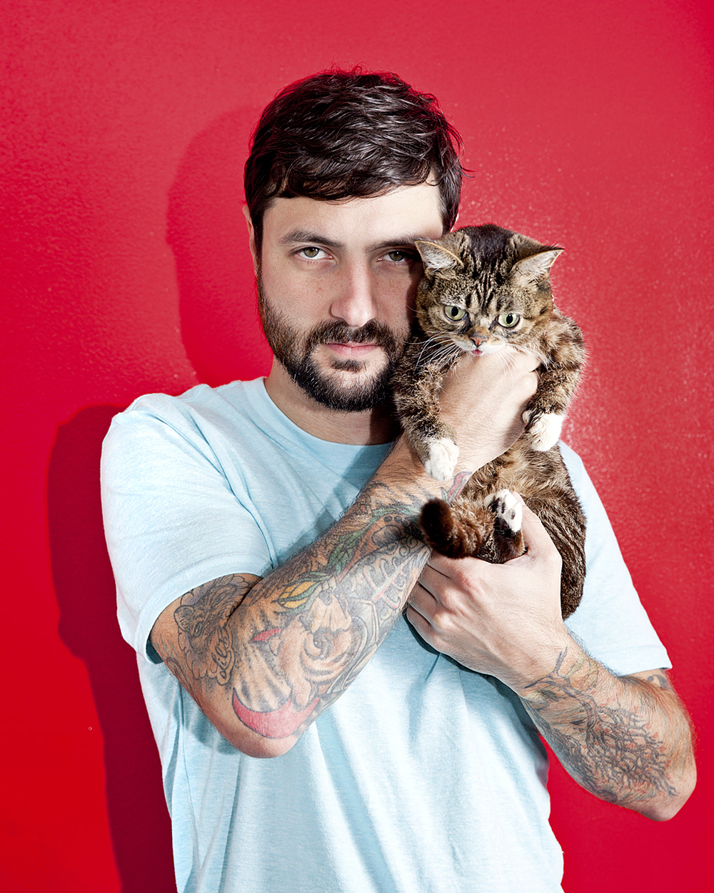 "Lil Bub  and her ""Dude"" Mike Bridavsky for WIRED."