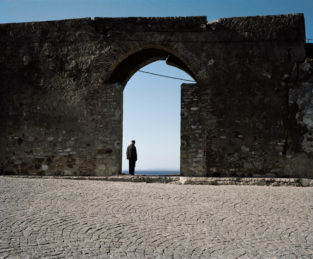 A man in Tangier, Morocco gazes at Spain in the distance. The Strait of Gibraltar, which separates the two, has taken the lives of thousands of undocumented migrants attempting to enter into the EU.