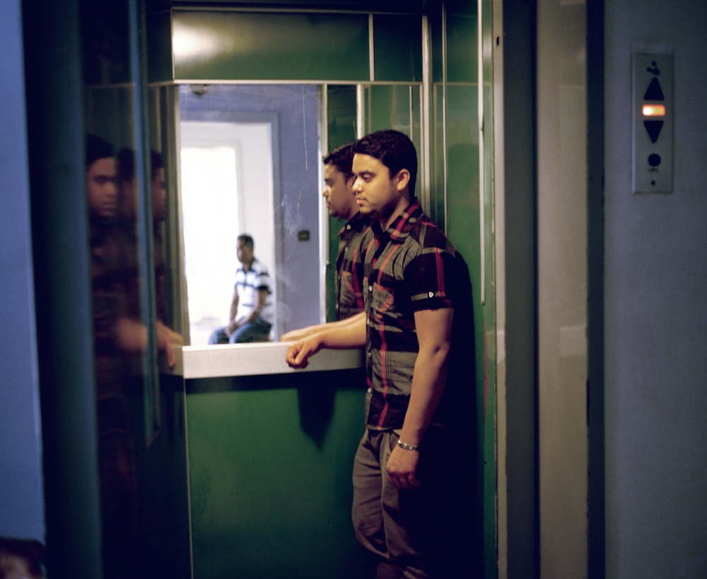 A migrant from Bangladesh in his building in Athens, Greece.