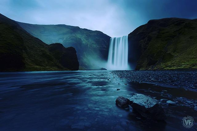 Falls - Skogafoss, Iceland 🇮🇸. It was early, it was cold, it was foggy, it was wet, it was slippery and yet mesmerizingly beautiful. Unforgettable Iceland.  Get Art to Your Wall - Link on the bio.