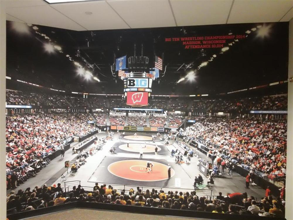 If you look closely, it's a wall mural in the Wisconsin Athletics Offices. Pretty cool.
