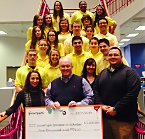 Bo Goliber of Fingerpaint presents a $5,000 check to Jim LaVigne, Brandy Crary, Matt Nelson &18 Saratoga Sponsor A Scholar students here...