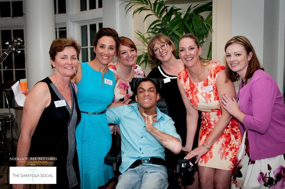 Karen & Gary Dake Foundation committee members posing with special guest Shamar Persaud