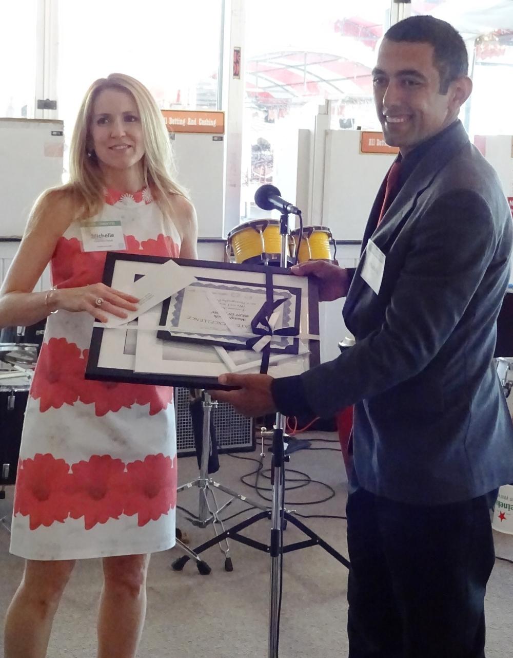 Michelle Paquette-Deuel congratulates 1st place winner Mustafa Guclu